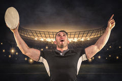 Composite image of rugby player cheering with the ball Royalty Free Stock Images