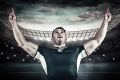Composite image of rugby player cheering and pointing Stock Photo