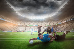 Composite image of rugby player doing a drop kick Stock Photo