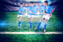 Composite image of rugby player doing a side pass Royalty Free Stock Photography