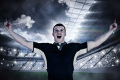 Composite image of a rugby player gesturing victory Stock Image
