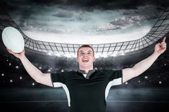 Composite image of a rugby player gesturing victory Stock Photography