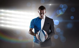 Composite image of rugby player holding ball Stock Images