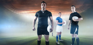 Composite image of rugby player holding rugby ball Stock Image