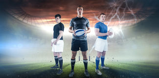 Composite image of rugby player holding rugby ball Royalty Free Stock Images