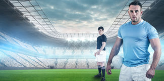 Composite image of rugby player holding a rugby ball Stock Images