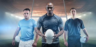 Composite image of rugby player holding a rugby ball Royalty Free Stock Photography