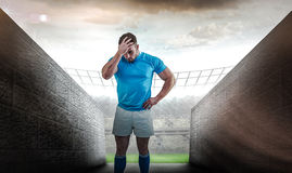 Composite image of rugby player after a loss Stock Photo