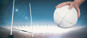 Composite image of a rugby player posing a rugby ball Stock Images