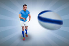 Composite image of rugby player ready to catch Stock Photography