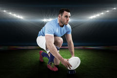 Composite image of rugby player ready to kick Royalty Free Stock Image
