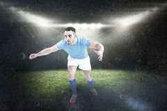 Composite image of rugby player ready to tackable Stock Photography