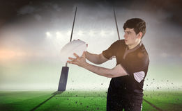 Composite image of rugby player receiving a side pass Stock Photo