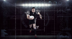 Composite image of rugby player running with the ball Royalty Free Stock Photography