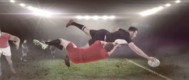 Composite image of a rugby player scoring a try Stock Photography