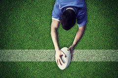 Composite image of a rugby player scoring a try Stock Photos