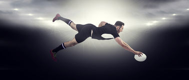 Composite image of rugby player scoring a try Stock Images