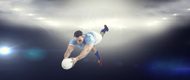 Composite image of rugby player scoring a try Stock Image
