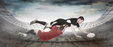 Composite image of a rugby player scoring a try Stock Images