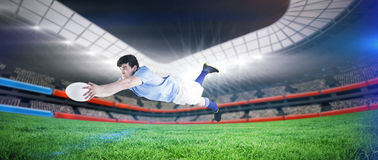 Composite image of a rugby player scoring a try Royalty Free Stock Photo