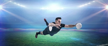 Composite image of rugby player scoring a try Royalty Free Stock Photography
