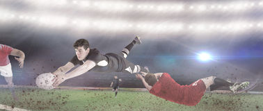 Composite image of a rugby player scoring a try Royalty Free Stock Image