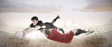 Composite image of a rugby player scoring a try Royalty Free Stock Images