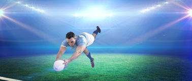 Composite image of rugby player scoring a try Royalty Free Stock Photos