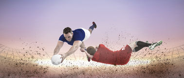 Composite image of a rugby player scoring a try Royalty Free Stock Photography