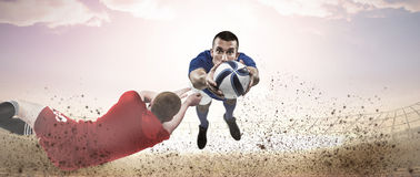 Composite image of a rugby player scoring a try Stock Photo