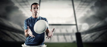 Composite image of rugby player trying to catch the ball Stock Photos