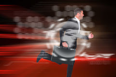 Composite image of running businessman Royalty Free Stock Photos