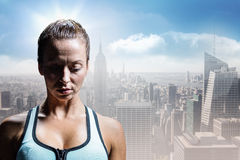 Composite image of sad athlete woman in sportswear. Sad athlete woman in sportswear against sunny city view Stock Photo