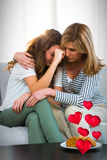 Composite image of sad family and floating love hearts 3d. Floating love hearts against mother comforting daughter 3d Stock Photo