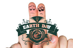Composite image of sad fingers. Sad fingers against earth day graphic Stock Images