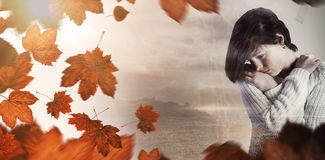 Composite image of sad pretty brunette thinking with arms crossed Royalty Free Stock Image