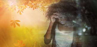 Composite image of sad woman holding her forehead with her hand royalty free stock photos