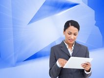 Composite image of saleswoman with her touch screen computer Royalty Free Stock Photo