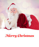 Composite image of santa asking for quiet with bag Stock Images