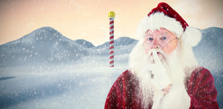 Composite image of santa asking for quiet to camera Stock Image