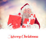 Composite image of santa carries a few presents Stock Photography