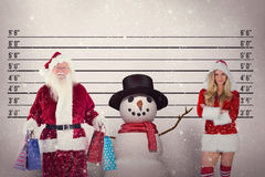 Composite image of santa carries some christmas bags Royalty Free Stock Photography