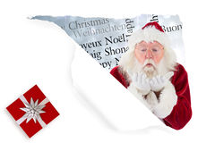 Composite image of santa claus blows something away Stock Photo