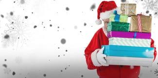 Composite image of santa claus hiding behind christmas presents Stock Photos