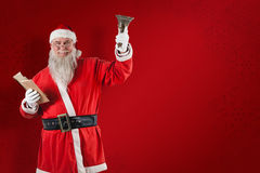Composite image of santa claus holding bible and bell. Santa Claus holding bible and bell against red snowflake background Stock Image