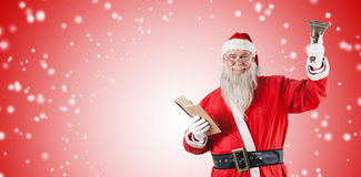 Composite image of santa claus holding bible and bell. Santa Claus holding bible and bell against white light dots on red Royalty Free Stock Images