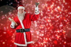 Composite image of santa claus holding bible and bell. Santa Claus holding bible and bell against white snow and stars on red Royalty Free Stock Photo