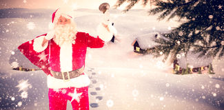 Composite image of santa claus holding a sack and bell Royalty Free Stock Photos