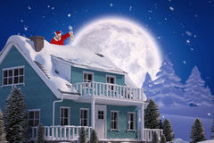 Composite image of santa claus looking at christmas lantern Royalty Free Stock Photos