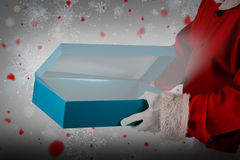 Composite image of santa claus opening gift box Royalty Free Stock Image